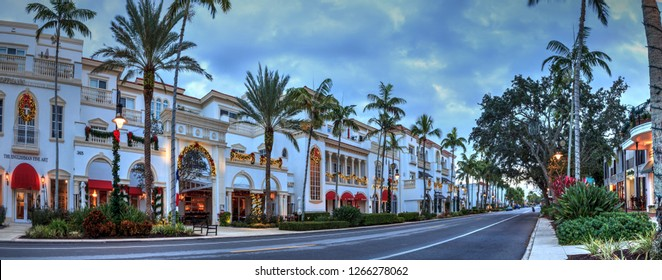 Naples, Florida, USA – December 22, 2018: Christmas lights as sunrises over The French restaurant along 5th Street in Old Naples, Florida.