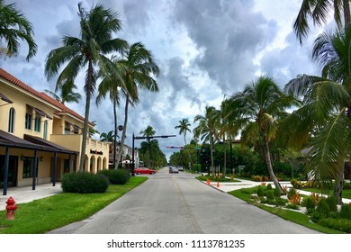Naples, Florida, USA - July 24, 2016: Gated community houses by the road in South Florida