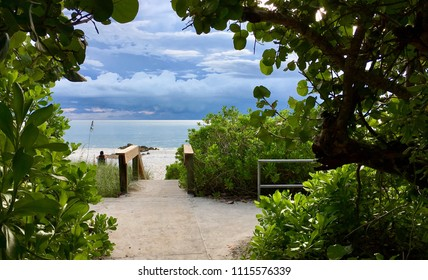 Naples, Florida, USA - July 24, 2016: Access path to the beautiful white sand beach in Naples. Florida, United States