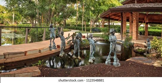 Naples, Florida, USA – June 24, 2018: Dalton Family Children's bronze sculptures at the Garden of Hope and Courage memorial garden and sanctuary in Naples, Florida.