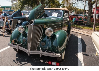Naples, Florida, USA – March 23,2019: Green 1936 Ford Convertible Sedan  at the 32nd Annual Naples Depot Classic Car Show in Naples, Florida. Editorial only.