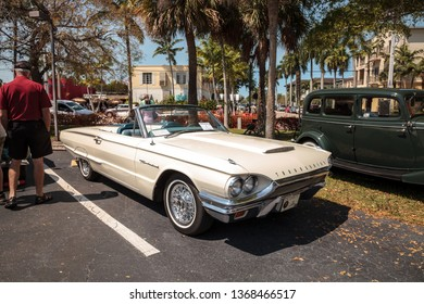 Naples, Florida, USA – March 23,2019: White 1964 Thunderbird Roadster at the 32nd Annual Naples Depot Classic Car Show in Naples, Florida. Editorial only.