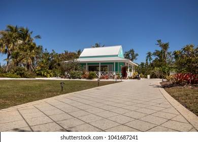 Naples, Florida, USA â?? March 4, 2018: Caribbean style bright green garden cottage at the Naples Botanical Gardens in Naples, Florida. Editorial use.