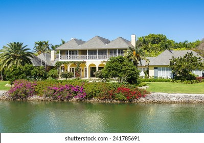 NAPLES, FLORIDA USA - May 8 2013: Waterfront  house with colourful gardens on the bayside area of Naples. Naples is one of the wealthiest cities in the United States