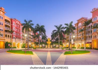 Naples, Florida, USA town skyline and city plaza at twilight.
