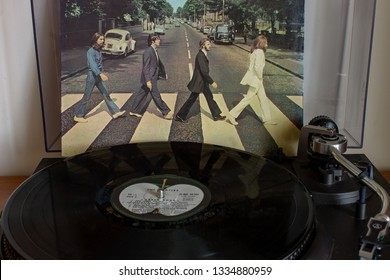 Naples, Italy, 10/03/2019. The fabulous Beatles depicted as they cross on the pedestrian crossing, on the cover of their most famous album Abbey Road.
