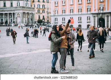 NAPLES, ITALY - 17 DECEMBER, 2017: Tourists make selfies at Piazza del Plebiscito in Naples, Campania, Italy.