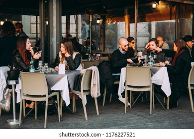 NAPLES, ITALY - 18 DECEMBER, 2017: People having dinner at the terrace of a street cafes in Naples, Campania, Italy.