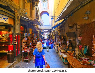 NAPLES, ITALY 20.05.2016. The big souvenir and statues colorful market on Via San Gregorio Armeno full of tourists in Naples.
