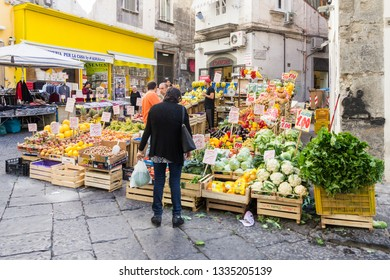 Naples, Italy - 21st September 2017: Fruit and vegetable stall, via San Liborio. There are many market stalls and food shops in this area.