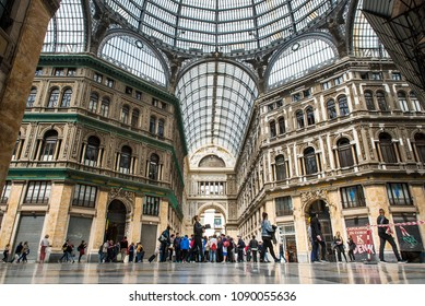 Naples, Italy - April 18, 2018. People walk inside Galleria Umberto I shopping gallery. Galleria Umberto I is a public shopping gallery, located directly across from the San Carlo opera house.