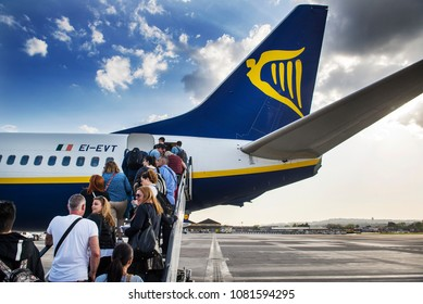 Naples, Italy - April 19, 2018. People board on a Ryanair Boeing 737-800 (EI-EVT) at Naples International Airport.