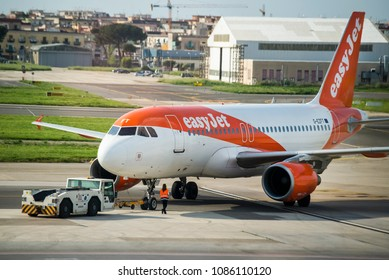 Naples, Italy - April 19, 2018. An easyJet Airbus A319 (G-EZFT) is being pushed back at the apron of Naples International Airport.