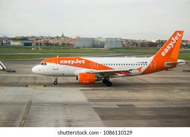 Naples, Italy - April 19, 2018. An easyJet Airbus A319 (G-EZBW) taxis at the apron of Naples International Airport.