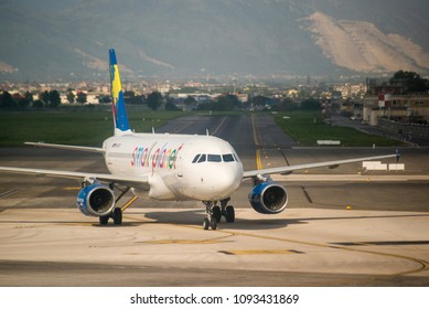 Naples, Italy - April 19, 2018. A Small Planet Airlines Airbus A320-200 (D-ASPE) taxis at Naples International Airport. Small Planet Airlines is a Lithuanian leisure airline based at Vilnius Airport.