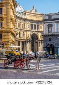 NAPLES, ITALY - AUGUST 17, 2011 - Horse carriage in front of the Galleria Umberto I.