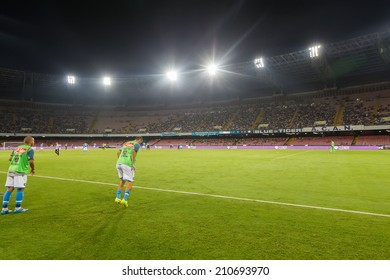 NAPLES, ITALY- AUGUST 2, 2014:  Wide view of the game,the stadium and the players of Napoli warming up during the friendly match Napoli vs Paok.
