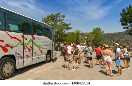 NAPLES, ITALY - AUGUST 2019: People waiting to board the Vesuvio Express, a shuttle bus service which takes visitors from Ercolano near Naples to the crater parking at the summit of Mount Vesuvius