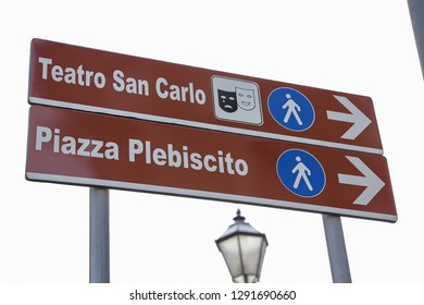 NAPLES, ITALY - AUGUST 22, 2018: Teatro San Carlo and Piazza Plebiscito Street Sign in Naples City, Italy