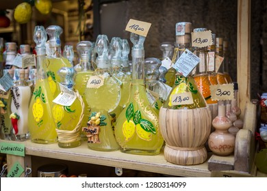 Naples, Italy - December 2018 - Bottles of Limoncello and Lemon related products in a souvenir shop in Naples Italy