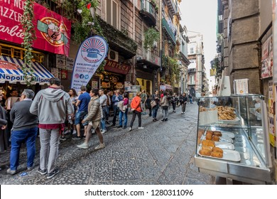 "Naples, Italy - December 2018 - People wait outside the famous ""Sorbillo Pizzeria Restaurant""  in order to find an empty table"