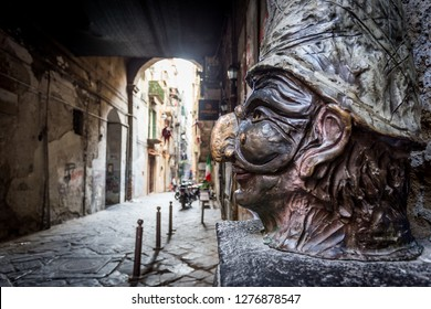 """Naples, Italy - December 2018 - Traditional mask with face of Pulcinella in """"Spaccanapoli Streets"""" in the old town of Naples, Italy"""