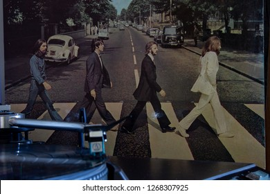 Naples, Italy - December 26 2018. Cover of the famous Beatles Abbey Road album with a turntable in the foreground.