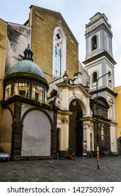 NAPLES, ITALY - DECEMBER 6, 2018: Facade of San Domenico Maggiore Church in the Old Town of Naples, Italy