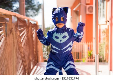 Naples Italy February 27, 2018. Child dressed as a catboy, animated cardboard Pj Mask