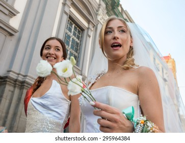 NAPLES, ITALY- JULY 11: Simulation of same-sex marriage to claim rights to sexual freedom to the legalization of gay marriage at the annual Gay Pride event in on July 11, 2015 in Naples, Italy.