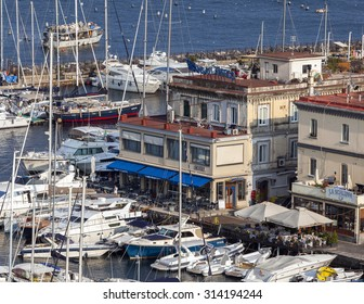 NAPLES, ITALY - JULY 21 2015: Borgo Marinaro in Naples, Italy is a small fishing village, famous for it's marina and restaurants, developed around the Castel dell'Ovo eastern wall in the 19th century.