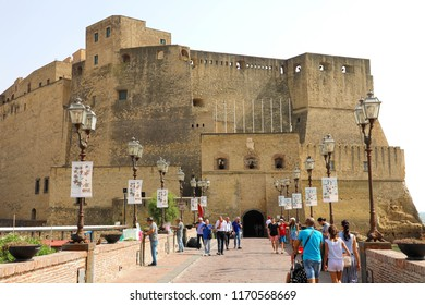 NAPLES, ITALY - JULY 5, 2018: tourists walking to Egg Castle (Castel dell'Ovo) a medieval fortress in Naples, Italy