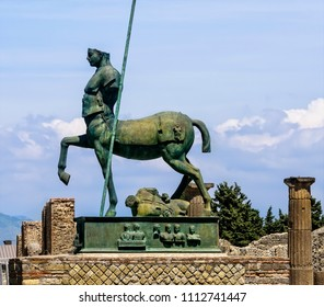 Naples, Italy - June 11, 2016:  Statue of a Centaur, a mythical creature, half horse and half man, displayed in the ruined city of Pompeii.