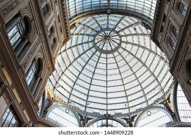 Naples, Italy - June 26, 2014; Interior of Galleria Vittorio Emanuele in Naples. Famous Italian shopping mall from Vittorio Emanuele chain with recognizable architecture glass dome shot from beneath.