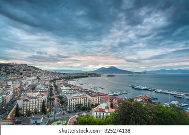 Naples, Italy. Landscape view of the city from Posillipo hill, during evening. Vesuvio volcano on the background.  - Shutterstock ID 325274138