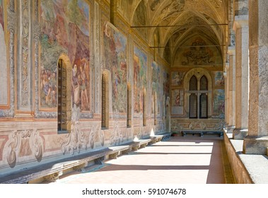 Naples, Italy - March 14, 2008:  Sacred paintings in   the Santa Chiara Monastery cloister