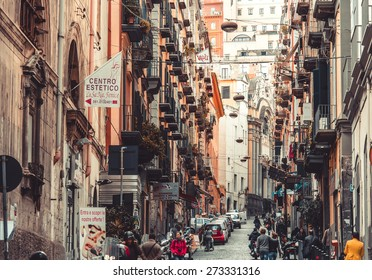 NAPLES, ITALY - MARCH 20, 2015: Classical romantic small street in the historical center of Naples, Italy. Naples is the the third-largest city in Italy with about 1 million residents