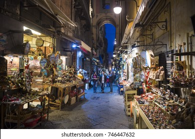 NAPLES, ITALY - OCTOBER 16, 2017: Night time view of the famous 'Christmas Alley' (Via San Gregorio Armeno) home to the Neapolitan Presepi (Nativity scene) stalls in the historic centre of the city