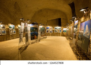 NAPLES, ITALY - OCTOBER 31, 2015: Local photo exhibition in the medieval castle Castel dell'Ovo. The Castel dell'Ovo is the oldest standing fortification in Naples.