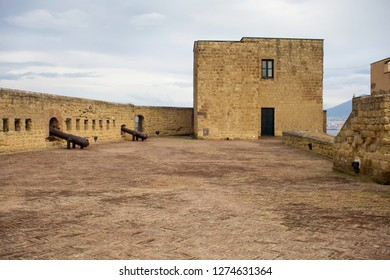 NAPLES, ITALY - OCTOBER 31, 2015: Defensive Fortifications and old guns of the medieval castle Castel dell'Ovo. The castle is the oldest standing fortification in Naples.