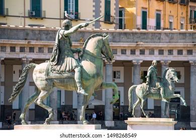 Naples, Italy - september 15, 2018: two equestrian monuments - Charles III (sculptor - Antonio Canova) and Ferdinand I (Antonio Cali) at the Plebiscito Square ( Piazza del Plebiscito ), citys main squ