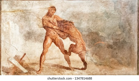 Naples - July 15, 2010: Fresco from Pompeii, Italy. Wall painting with Hercules fighting a lion. Ancient Roman mural inside the Pompeii house.  Old frescoes are the landmark of Pompeii.