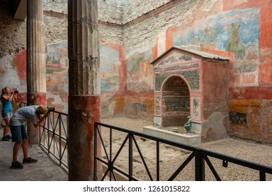 Naples/ Pompeii/ Italy July 2017 - Interior of the House of the Small Fountain (Casa della Fontana piccola) with frescoes around the fountain in ancient roman city of Pompeii destroyed by the eruption