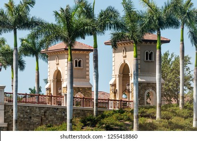 Naples, USA - April 30, 2018: The Peninsula at Treviso Bay gated residential community modern architecture entrance street road in Florida