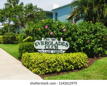 Naples, USA - May 8, 2018: Exterior of a two-story modern resort building Everglades Club at Green Village at Naples, Florida