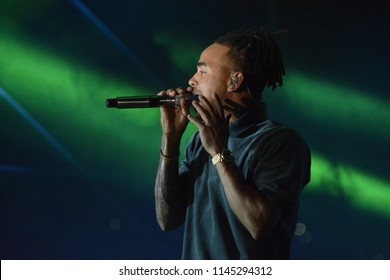 NAPLES,ITALY-July 29, 2018: Juan Carlos Ozuna Rosado, known by his stage name Ozuna, a Puerto Rican reggaeton and Latin trap singer performing live on stage  at Ippodromo di Agnano in Naples, Italy.