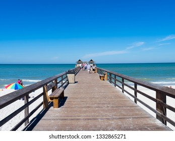 Naples/USA - April 24 2016: The long pier of caribbean beach of Naples in Florida - USA. Naples is a city in Collier County, Florida, United States.