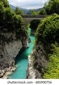 Napoleon bridge over emerald Soca river in Julian alps, Slovenia, is the rafting paradise for adrenaline seekers and also nature lovers