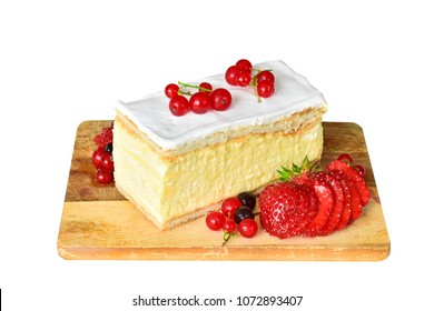 Napoleon cake with vanilla custard served with fresh summer Strawberries,filled with pastry cream and decorated with fruits, Light dessert a classic millefeuille cake decorated with and strawberries.