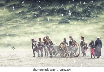 Napoleon soldiers marching in falling snow and pulling a cannon with them.The Battle of Austerlitz. The Battle of the Three Emperors